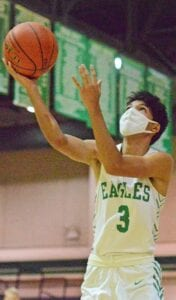 Pleasanton junior Juan Lopez goes for a ayup during the Eagles' win over Lanier on Friday, Nov. 20. Lopez posted a team-high 16 points to help the Eagles beat the Eagle Pass Winn Mavericks 76-34 at home on Saturday, Nov. 28. Lopez also had 10 points against YMLA on Tuesday. SAM FOWLER | PLEASANTON EXPRESS
