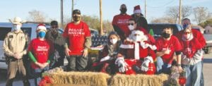 The Atascosa County Project Christmas elves are pictured with Santa and Mrs. Claus. Shown left to right are: Atascosa County Sheriff's Deputy- Guy Bruce, Atascosa County Project Christmas president- Julie Bruce, Alan Bruce, Brenda Hasler, Mrs. Claus, Santa Claus, Alan Moore, Patricia (Cissie) Sharp, Jamie Sharp; middle row- Toni Moore and back row: Teddy Pomroy and Abigayle Bruce. Not pictured are Atascosa County Project Christmas secretary/ treasurer/photographer, Karen Hearn and Atascosa County Sheriff's Deputy Chris Gomez. KAREN HEARN | COURTESY PHOTOS