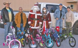 Atascosa County Project Christmas received a gift donation from the 3013 BBQ Smokehouse in Poteet, which was much appreciated. Pictured left to right are: Donovan Garcia, Xavier J. Garcia, Santa Claus, Mrs. Claus, Ronin Garcia and Marcello Alvarado. See more photos from the event on page 12A.