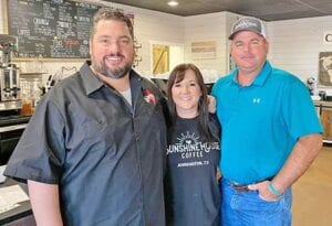 "Shane McAuliffe, award-winning reporter and host of the program ""The Texas Bucket List,"" stopped by Sunshine House Coffee Monday morning to interview Audrey and Kevin McCleary and get their story behind #spreadkindnessforMandT and how the coffee shop got started. The show will premiere at a later date this spring. Pictured, from left, are Shane McAuliffe with Audrey and Kevin McCleary. AUDREY MCCLEARY 