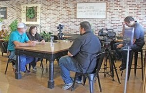 "Kevin and Audrey McCleary (left) being interviewed by Shane McAuliffe of ""The Texas Bucket List"" program Monday morning at Sunshine House Coffee. REBECCA PESQUEDA 