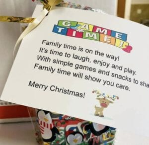 """The Woman's Club of Pleasanton prepared baskets and sent each family a sweet note that reads: """"Family time is on the way! It's time to laugh, enjoy and play. With simple games and snacks to share. Family time will show you care. Merry Christmas!"""""""