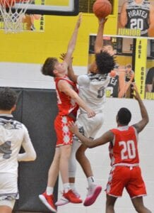 Clyde Schuchart attempts to block a Lytle layup in the Indians' 75-69 win on Friday, Jan. 1. Schuchart hit a pair of free throws late in the game to seal the win for Jourdanton. VORI BALDERAZ | COURTESY PHOTO