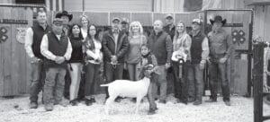 Bidding on Avery Guzman's Reserve Grand Champion Goat during the live auction on Saturday, Jan. 16 were Shane Schuchart, Allways Atascosa Dodge; Ray Guzman, dad; Randy Gaydos, Gaydos Construction; Jackie Brown, Security State Bank; Sherry Gaydos, Gaydos Construction; Vanessa Guzman, mom; Bob Price and Harry Garza, Price Chevrolet Pleasanton and Price Chrysler Floresville; Aubrey Smith, Pleasanton H-E-B; Avery Guzman holding her Res. GC Goat; Chris Morlock, Pursch Motors; Chris Jenschke, Forage Specialties; Lizzy with ribbons and Greg Vyvlecka, 5V Graphics; and David Dove, Mac Haik Southway Ford. Avery's goat raised $4,500. MEMORIES ON MAIN