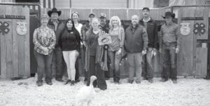 McKenzie Lutz with Jourdanton FFA, raised $4,030 with her Reserve Grand Champion Turkey at the live auction on Saturday, Jan. 16. Pictured, from left, are buyers: Grandmother, Linda Ramey, Ramey Insurance; Randy Gaydos, Gaydos Construction; Jackie Brown, Security State Bank; Sherry Gaydos, Gaydos Construction; Bob Price, Price Chevrolet Pleasanton and Price Chrysler Floresville; McKenzie Lutz, Res. GC Turkey; Harry Garza, Price Chevrolet Pleasanton and Price Chrysler Floresville; Aubrey Smith, Pleasanton H-E-B; Chris Morlock, Pursch Motors; Walt Rakowitz, Rakowitz Engineering; and David Dove, Mac Haik Southway Ford. MEMORIES ON MAIN