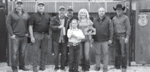 Reserve Grand Champion Rabbits raised $3,000 for Alexa Parrish with La Parita 4-H during the live auction on Saturday, Jan. 16. Pictured, from left, are buyers: Evan Walker and Jerry Stacey, Tuttle Motor Co.; Bob Price holding ribbons and Harry Garza, Price Chevrolet Pleasanton and Price Chrysler Floresville; Alexa Parrish holding her Res. GC Rabbits; Aubrey Smith holding the plaque, Pleasanton H-E-B; Chris Morlock, Pursch Motors; and David Dove, Mac Haik Southway Ford. MEMORIES ON MAIN