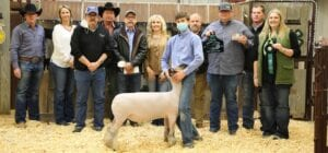 Beidler Weiss with Mesquite 4-H raised $5,000 with his Grand Champion Lamb. Pictured, from left, are buyers: David Dove, Mac Haik Southway Ford; Sherry Gaydos, Gaydos Construction; Harry Garza, Price Chevrolet in Pleasanton and Price Chrysler Floresville; Randy Gaydos, Gaydos Construction; Bob Price, Price Chevrolet Pleasanton and Price Chrysler Floresville; Aubrey Smith, Pleasanton H-E-B; Beidler Weiss holding his GC Lamb; Chris Morlock, Pursch Motors; Josh Powell holding buckle and plaque, Primo's Feed & Supply; Shane Schuchart, Allways Atascosa Dodge; and Kelsey Barry holding ribbons, Primo's Feed & Supply. MEMORIES ON MAIN