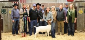 During the live auction on Saturday, Jan. 16, the Grand Champion Goat raised $4,000 for Hailey Satterfield with Jourdanton FFA. Pictured, from left, are buyers: David Dove, Mac Haik Southway Ford; Kristy Parker with ribbons, TX Sold, LLC; Sherry Gaydos, Gaydos Construction; Harry Garza, Price Chevrolet Pleasanton and Price Chrysler Floresville; Randy Gaydos, Gaydos Construction; Bob Price, Price Chevrolet Pleasanton and Price Chrysler Floresville; Hailey Satterfield holding her GC Goat; Aubrey Smith, Pleasanton H-E-B; Chris Morlock, Pursch Motors; Josh Powell and Kelsey Barry, Primo's Feed & Supply. MEMORIES ON MAIN