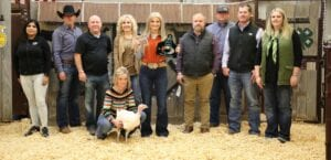 Jourdanton FFAer, Ally Sherley raised $4,305 with her Grand Champion Turkey at the live auction on Saturday, Jan. 16. Buyers, from left, were: Jackie Brown, Security State Bank; David Dove, Mac Haik Southway Ford; Jeff Lawrence, dad; Aubrey Smith, Pleasanton H-E-B; Ally Sherley with ribbons; Chris Morlock, Pursch Motors; Josh Powell, Primo's Feed & Supply; Shane Schuchart, Allways Atascosa Dodge; and Kelsey Barry, Primo's Feed & Supply. At front, holding the GC Turkey is mom, Nikki Lawrence. MEMORIES ON MAIN