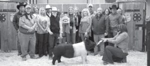 The Reserve Grand Champion Hog raised $4,500 for Samuel Hansen with Somerset FFA at the live auction on Saturday, Jan. 16. Buyers, pictured from left, were: Randy Gaydos, Gaydos Construction; Douglas Black, Samuel Dean Sheet Metal; Sherry Gaydos, Gaydos Construction; Rachel Wright and Kevin Sparks, Mark Sparks; Res. GC Hog winner Samuel Hansen; Debbie Black, Samuel Dean Sheet Metal; Morgan Hansen, sister with ribbons; Elizabeth Hansen, mom; Aubrey Smith, Pleasanton H-E-B; Will Hansen, dad; Chris Morlock, Pursch Motors; Olivia Arriega, Sylo; David Dove, Mac Haik Southway Ford; and Jesse Arriega Jr., Sylo. Tammy Shannon is pictured helping with the Res. GC hog. The auction was live through Monday, Jan. 18. Final sale totals will run in our livestock show wrap up in the Feb. 3 issue. MEMORIES ON MAIN