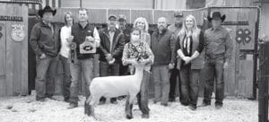 Isabella Weiss with Mesquite 4-H, raised $3,000 with her Reserve Grand Champion Lamb. Pictured, from left, are buyers: Randy and Sherry Gaydos, Gaydos Construction; Shane Schuchart with ribbons, Allways Atascosa Dodge; Bob Price and Harry Garza, Price Chevrolet Pleasanton and Price Chrysler Floresville; Isabella Weiss holding her Res. GC Lamb; Aubrey Smith, Pleasanton H-E-B; Chris Morlock, Pursch Motors; Josh Powell and Kelsey Barry, Primo's Feed & Supply; and David Dove, Mac Haik Southway Ford. MEMORIES ON MAIN