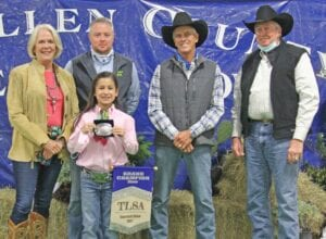 The 2021 McMullen County Grand Champion Steer went to Bailey Ruiz (holding banner and buckle) with her Class 3 market steer and sold for $14,000 at the auction Saturday morning. Pictured with Ruiz, from left, are buyers Carol Harris with Tyler Ranch Partners; Jason Jones with School House Syndicate; Walt Franklin with Atascosa Syndicate and Bob Siddons with Beefmasters Syndicate. Ruiz also won the Reserve Grand Champion Steer with her Class 2 market steer. MARY PATE | COURTESY PHOTO