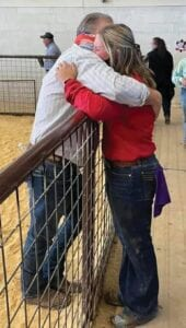 Kendall gives her Step-dad, Dennis Jasik, a hug at the Atascosa County Livestock Show.