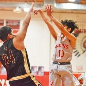 Sean Luna hits a three-pointer over the outstretched arms of a Cotulla defender during Jourdanton's 85-35 win on Friday, Feb. 12. Luna hit a team-high three three-pointers in their emphatic season finale win. SAM FOWLER | PLEASANTON EXPRESS