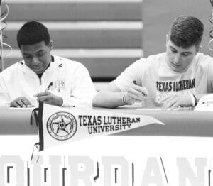 Jarel Lilly and Cole Andrus signed to continue their football careers at Texas Lutheran University on Wednesday, Feb. 10. The two have played football together since they were in sixth grade. Getting to continue that at the next level is something special, according to Lilly. SAM FOWLER | PLEASANTON EXPRESS