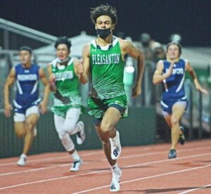 Pleasanton senior Ashon Thompson leaves the competition in the dust during the 100-meter dash. Thompson ran a 10.61 to win the event and also anchored Pleasanton's first place finishes in the 400- and 800-meter relays. SAM FOWLER | PLEASANTON EXPRESS