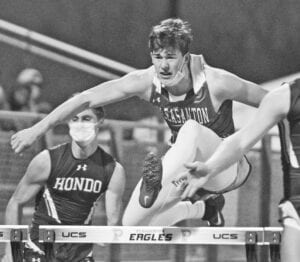 Justin Veale clears a hurdle during the 110-meter hurdle event at the Pleasanton track meet on Wednesday, Feb. 10. Veale finished in second place. SAM FOWLER | PLEASANTON EXPRESS