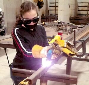 Lorena Leal, Poteet FFA, using a plasma cutter to cut one of the leg supports for her resin table which won her a blue ribbon at the ACLS. Look in next week's issue for a feature story on Leal. COURTESY PHOTO