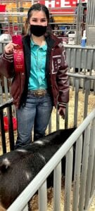 Julia Smith, Poteet FFA, won second place with her Spot Gilt at the San Antonio Stock Show. COURTESY PHOTO