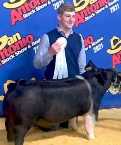 Jayce Krauskopf, Pleasanton FFA, won third place with his Hampshire Barrow at the San Antonio Stock Show. COURTESY PHOTO