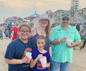 Gabby Peña, Genevieve, Rhonda and Will Chancellor at the 2019 Poteet Strawberry Festival. Watch for the Poteet Strawberry Festival Special in the April 7 issue of the Pleasanton Express which features entertainment schedule, festival foods and costs, maps, parade information and more. NOEL WILKERSON HOLMES   PLEASANTON EXPRESS