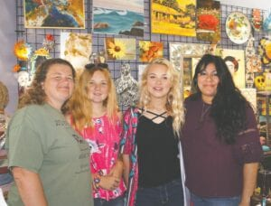 Inviting the community to the Peace for the Pieces Social Group Autism Awareness Day on April 17 at the Pleasanton River Park are, left to right: Missy Thomas, Harley Williams, Bailey Williams and Laura Calvert. They are shown at Art on Main Co-Op Creations, 216 N. Main St. in downtown Pleasanton. Not pictured are Toni Miranda and Wendy Saunders. LISA LUNA | PLEASANTON EXPRESS