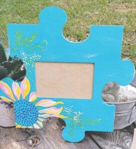 "This beautiful puzzle piece painted by local artist Darla Royal is one of many puzzle pieces currently up for bid on the ""Peace for the Pieces Social Group Silent Auction"" event page on Facebook. All bids start at $5. Puzzle pieces were crafted by the Pleasanton High School woodworking students. LAURA CALVERT 
