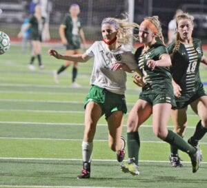 Brandi Barnett fights off a Canyon Lake defender late in the second half of Pleasanton's 2-1 loss in the area round of playoffs on Tuesday, March 30. SAM FOWLER | PLEASANTON EXPRESS