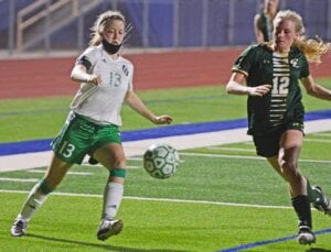 Brylee Miller looks to play a ball into the box late in the second half of Pleasanton's 2-1 loss to Canyon Lake in the area round of playoffs on Tuesday, March 30. SAM FOWLER | PLEASANTON EXPRESS
