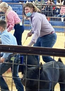 Tate Yow intently focuses on the judge at the 2021 Atascosa County Livestock Show. The Jourdanton sophomore placed 8th in the cross division, COURTESY PHOTO
