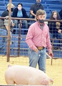 Jourdanton 6th grader, Brody Yow is pictured with his Chester class hog in January at the Atascosa County Livestock Show. Proud parents of Madison, Tate and Brody are Nikki and Rowdy Yow. COURTESY PHOTO