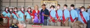 Selso Garcia of S & G Farm was named the Grand Champion winner at this year's Poteet Strawberry Festival Show and Auction. The winning berries of the Chandler variety have brought in $7,800 total to date. This year's auction is a hybrid of the in-person auction held on April 10 and contributions that can be made by email until Friday, April 16 (see story on how to bid). Pictured, from left, are: Poteet Strawberry Festival Duchess Sinthia Garcia, Duchess Taylor Fojtik, Duchess Alexandria Gonzalez, Princess Madison Maglievaz, Queen Kathlene Rodriguez, Aubrey Olle Smith- H-E-B Pleasanton #411 Top Store Leader, Selso Garcia, King Ricardo Natal, Prince Michael Oliva, Duke Jaythan Zuniga, Duke Carlos De Leon and Duke Jacob De La Garza. For the full list of buyers for the Grand Champion and Reserve Grand Champion winners, see related story. The complete list of buyers will be published after bidding is closed on April 16, as well as more photos of the Grand Champion and Reserve Grand Champion bidders. Bidding is still open. Please see information on how to bid on 2A. LISA LUNA | PLEASANTON EXPRESS