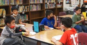 Poteet Elementary students enjoy pizza, following the announcement that they were one of the winning campuses in the subdivision naming contest. LISA LUNA   PLEASANTON EXPRESS
