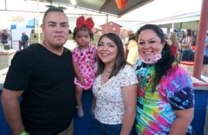 It's her berry first Poteet Strawberry Festival! Pictured are Eli Perez, Everly Perez, Emry Espinosa and Erika Oliva-Perez.