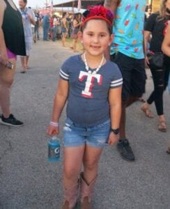Cataleya Ramirez, Poteet kindergartener, booted up for the festival.