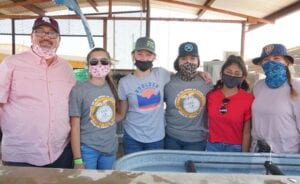 Poteet ISD Superintendent Charles Camarillo and students raise funds for FFA