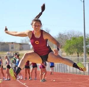 Charlotte junior Mia Campos is one of nine Trojanettes heading to the area meet. Campos' 15-feet-2.25-inch jump placed second at the district meet in Falls City on Wednesday, April 7. MERCEDES SANCHEZ | PLEASANTON EXPRESS