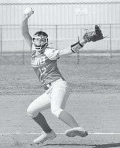 Pleasanton pitcher Mackinzy Curbow rares back to rifle a pitch home during the Lady Eagles' 16-0 win over Brooks Academy on Friday, April 9. Brooks picked up the win in the circle, allowing just one hit during the three-inning, run-rule game. SAM FOWLER | PLEASANTON EXPRESS