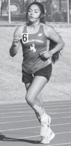 Sianna Serrata runs a distance race during the area track meet in Medina. Serrata finished second in the 3200-meter run to advance to the Region IV-1A meet at Challenger Columbia Stadium in Webster. MARY PATE | MCMULLEN COUNTY ISD