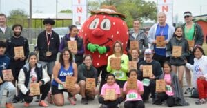 Winners in the 5K and 1 Mile Berry Run/Walk display their plaques and medals. DIANA G. LEAL | COURTESY PHOTOS