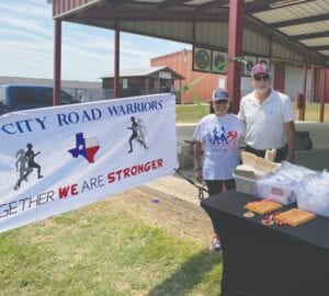 TRiCiTy Road Warrior Diana G. Leal joins her husband Mayor Willie Leal, ready to hand out medals at the Poteet Strawberry Festival 5K and 1 Mile Berry Run/Walk held April 3. DIANA G. LEAL | COURTESY PHOTO