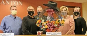 The Pleasanton City Council honored the late Robert Earl Wood, District 5 Councilman, during the April 15 city council meeting with a cowboy themed wreath and Bird of Paradise candle lit in his honor in his seat. Pictured, from left, are District 2 Councilman Kenneth Hernandez, District 4 Councilman JR Gallegos, Mayor Travis Hall Jr., District 3 Councilwoman Diana Prasifka and District 6/Mayor Pro Tem Britni Van Curan. REBECCA PESQUEDA | PLEASANTON EXPRESS