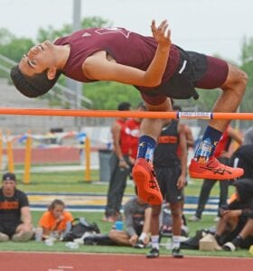 Poteet's Noah Gonzales clears the high jump bar during the District 27/28-3A area meet in Poth on Wednesday, April 14. Gonzales won high jump with a height of 6-feet and will compete at the regional meet. SAM FOWLER | PLEASANTON EXPRESS