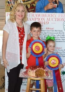 Aubrey Olle Smith (left), H-E-B Pleasanton #411 Top Store Leader, Grand Champ (junior) Bowen Walla and sister Hadley Walla. Walla's Carrot Cake with Butterfinger Frosting sold for $2,300 to buyers: Atascosa Ag, Best-1 Hummingbird Feeders, Anthony and Jessica Badillo, Jupe Environmental Inc., Glazers Beer, H-E-B Pleasanton, Jeff and Sue Ann Smith, Larry and Janet Bartek, Michele Higginbotham and Ed McClure (Edward Jones), Pleasanton Express, Poteet Lions Club, Poteet Rotary Club, Poteet VFW Post 6970, Tank Hollow Fisheries and KH Farms. JOE DAVID CORDOVA | PLEASANTON EXPRESS