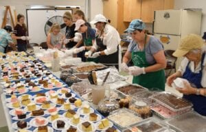 Such a sight for dessert lovers- volunteers prepare cake plates for the 2019 St. Andrew Catholic Church Picnic. PLEASANTON EXPRESS FILE PHOTOS
