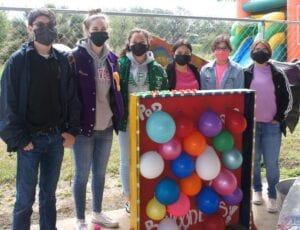 Above, local students volunteer their time with games at the Autism Awareness Day event.