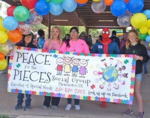Laura Calvert, third from left and the Peace for the Pieces Social Group hosted Autism Awareness Day at the Pleasanton River Park on April 17. LISA LUNA | PLEASANTON EXPRESS PHOTOS