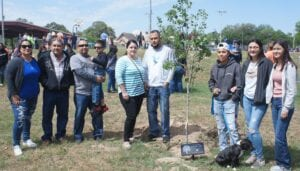 In memory of Desiree Anger, a tree-planting ceremony was held as part of the Autism Awareness Day event on April 17. Pictured from left are: Vanessa Anger, Daniel Balderaz, Eric Anger, Izyk Anger, Crystal Escamilla, Jason Escamilla, Marissa Garcia, Angelina Romero and Janel Escamilla. LISA LUNA | PLEASANTON EXPRESS PHOTOS