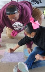 Chalked out puzzle pieces, sponsored by local businesses and individuals, were filled in by those attending the event.