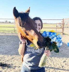 Gonzales with her mustang Sky after signing her National Letter of Intent to ride for the South Dakota State University Jackrabbit equestrian team. LESLIE GONZALES | COURTESY PHOTO